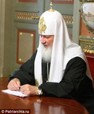 Now you see it: Patriarch Kirill wearing his watch, said to be a luxury Swiss-made Breguet timepiece worth £20,000, in a meeting with Russian justice minister Alexander Kolarov