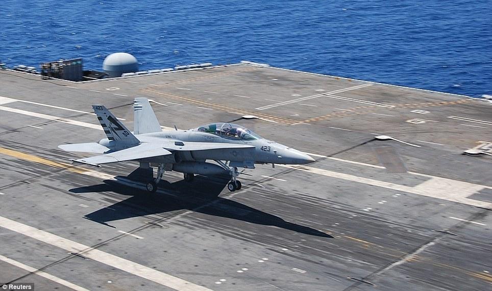 Elite aircraft: An F/A-18D Hornet is seen landing on an aircraft carrier (stock photo)