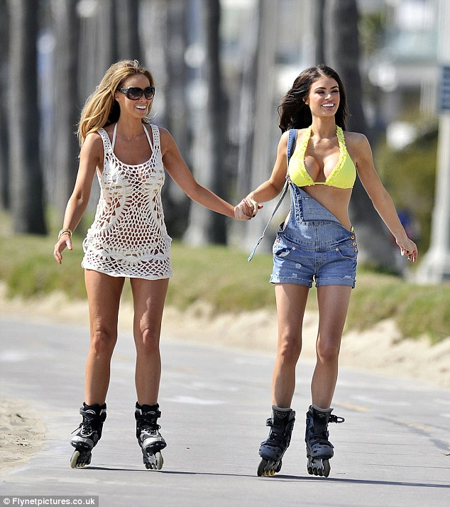 Sisters in arms: Lauren Pope and Chloe Sims go rollerblading by the beach while on holiday in California, yesterday afternoon