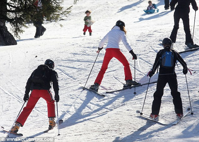 William and Kate make their way up the slopes with brother James on their holiday