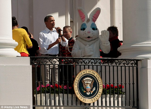 Easter Egg Roll: President Obama  and the Easter Bunny wave to a crowd of thousands of kids and parents gathered on the South Lawn