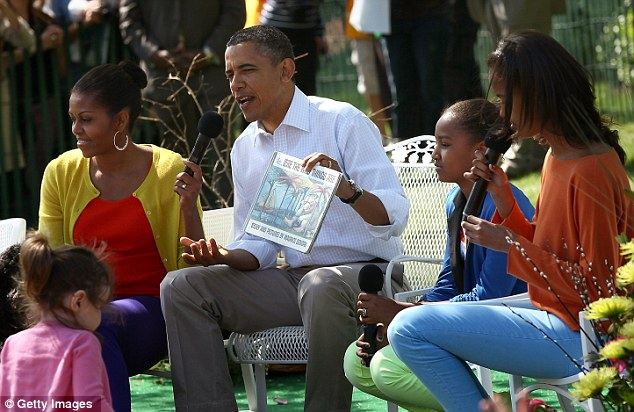 Hands on President: Barack  reads from the book 'Where The Wild Things Are' with first lady Michelle and his daughters Sasha (second right) and Malia (right)