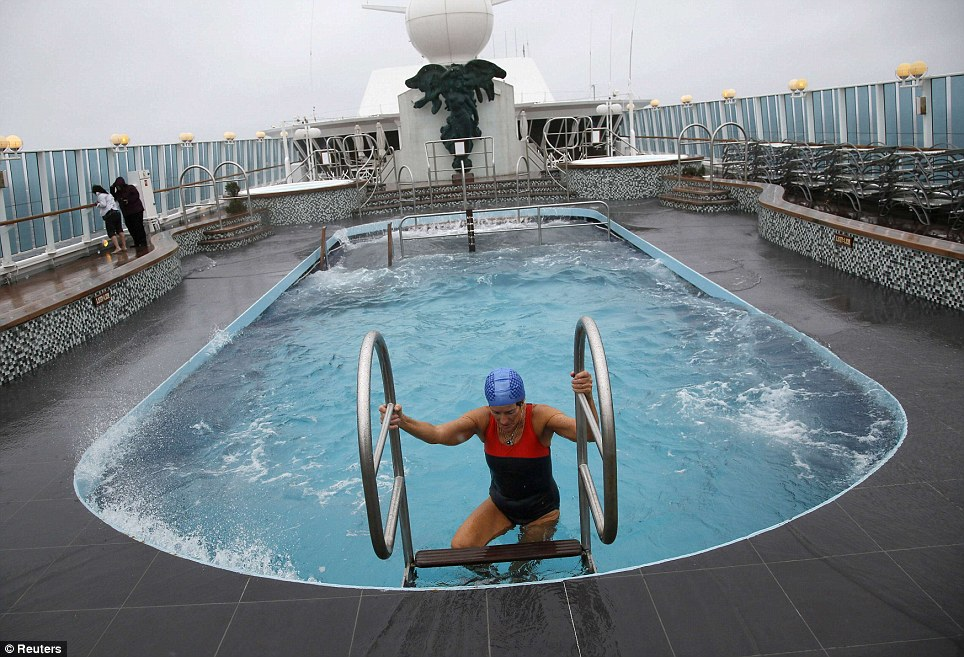 Quick dip: Merri Mack of Sydney, Australia ,climbs out of the top deck pool on the Titanic Memorial Cruise as it moves through high winds. Force eight winds delayed the arrival in Cobh by several hours