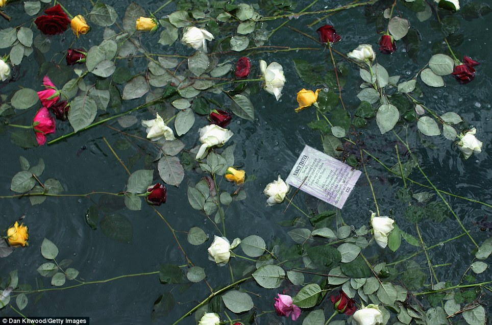 Commemorative roses line the water between the two births where the Titanic originally set off from on April 10 1912