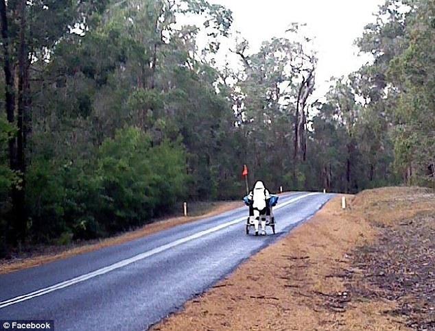 Elite soldier Jacob French dressed in his Stormtrooper costume walking across Australia