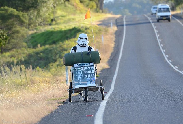 On his way: Jacob French pushed a buggy with all his supplies to keep him going