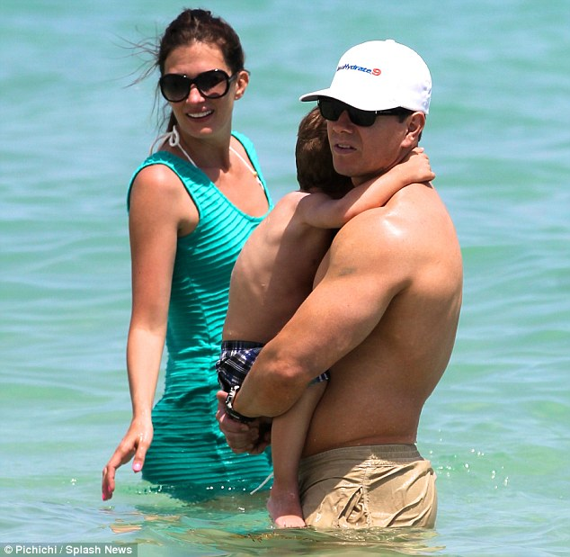 Body shy? She hid her great frame in a turquoise dress which she wore into the ocean