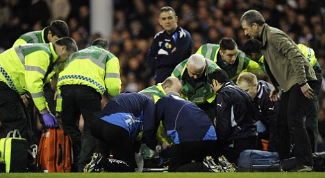 Concern: Bolton boss Owen Coyle watched the medics treat Muamba