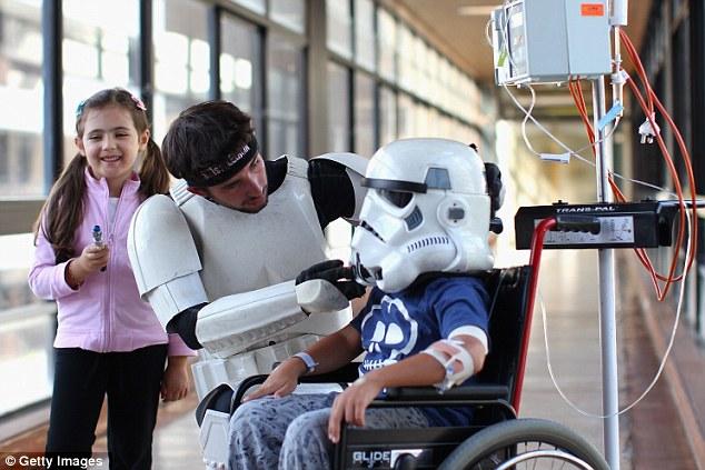 White knight Jacob French with patients Helena Kantarelis and Zak Brankstone at Sydney Children's Hospital