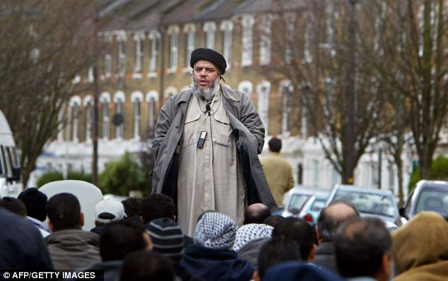 Controversial: Abu Hamza addresses followers during Friday prayer outside Finsbury Park mosque in north London, in 2004, with the kind of rant that drew attention from the authorities