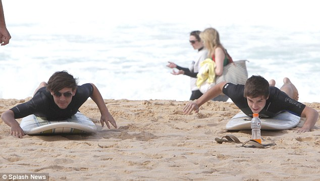Copycats! Liam Payne and Louis Tomlinson tackle the waves at Sydney's Manly Beach in a scene similar to The Monkees back in the sixties