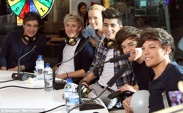 Having fun: The boys (L-R) Liam Payne, Niall Horan, Zayn Malik, Harry Styles and Louis Tomlinson made an appearance on the Kyle and Jackie O radio show yesterday
