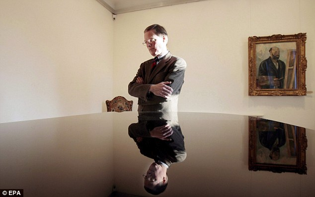 Bare walls: Lukas Gloor, CEO of the E G Buehrle collection in Switzerland looks towards the bare wall where the Cezanne, a Monet, van Gogh and Edgar Degas were taken in 2008