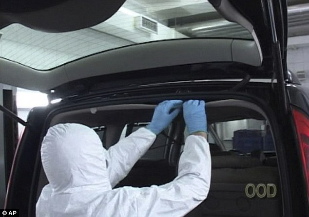 Search: A Serbian forensic officer searches a vehicle for the masterpiece in Belgrade