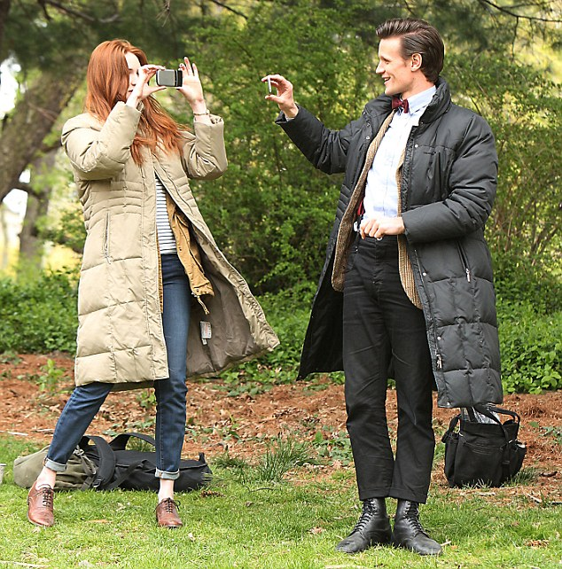 Filming... The duo shoot each other on their phones during a break on set