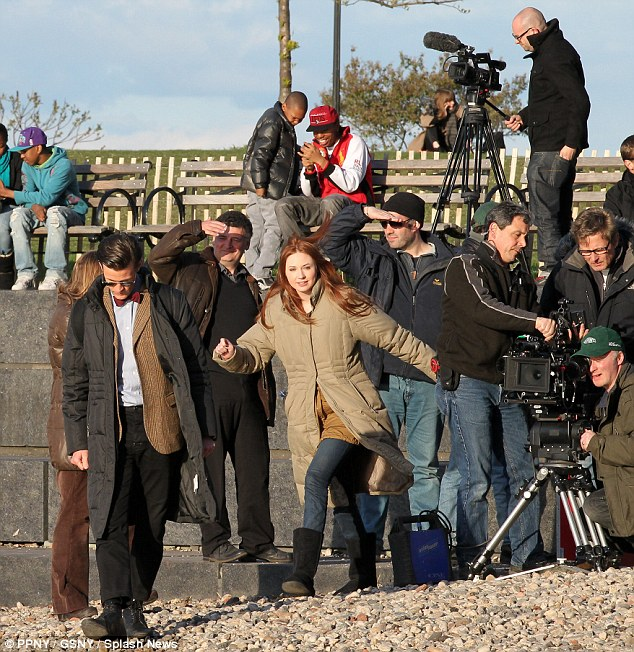 Life's a beach: Matt and Karen are surrounded by the film crew on the pebbles next to the Hudson River