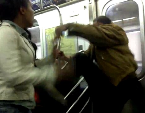 Getting out of control: The man lashes out at the woman after she kicked him a number of times