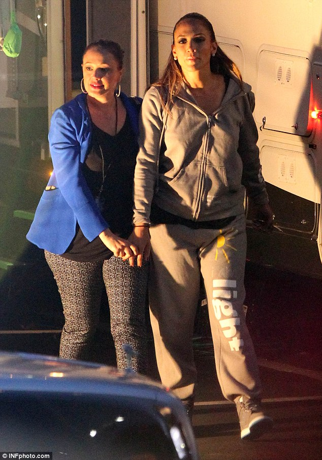 Baggy trousers: J-Lo slouched around in grey tracksuit with the word 'light'