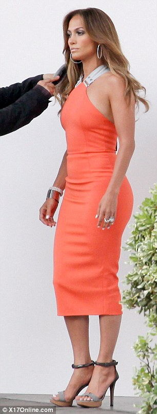 Just... wow! Jennifer Lopez showed off her stunning figure in a tangerine coloured Victoria Beckham dress as she arrived at the American Idol studio