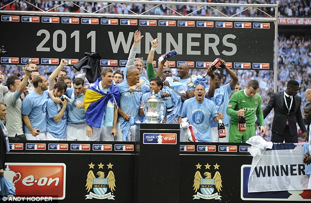 The one they want: This weekend's winners will be hoping to go on and lift the cup as Man City did last season
