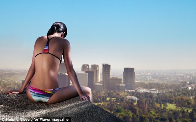 Breathtaking view: In one shot Kendall perches on the side of a wall at the impressive mansion