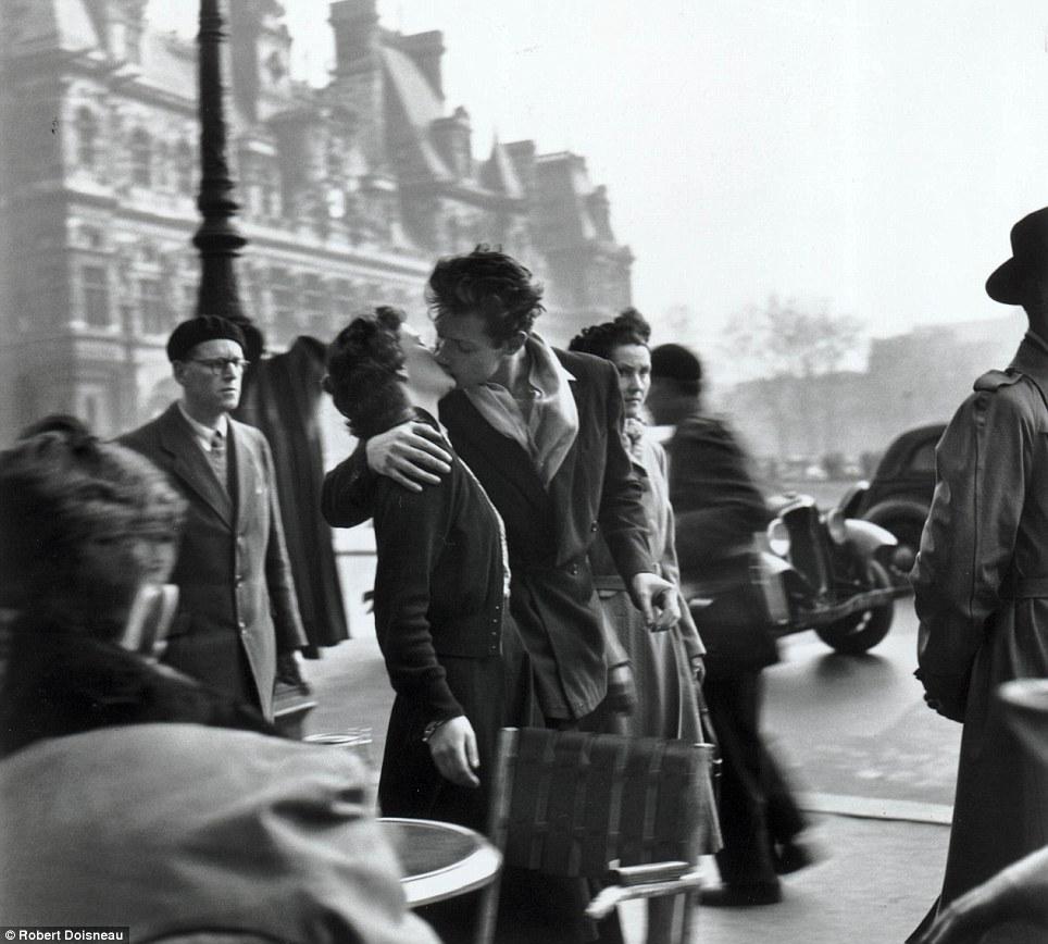 Robert Doisneau's Le baiser de l'hotel de ville (Kiss by the Hotel de Ville), which shows a young couple kissing amid the hustle and bustle of a Paris street.