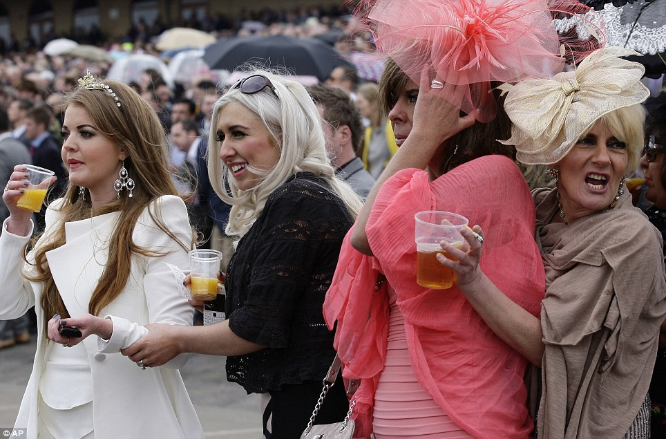 Drink up, girls: This group of friends get ready for the big race of the day with orange juice and beer