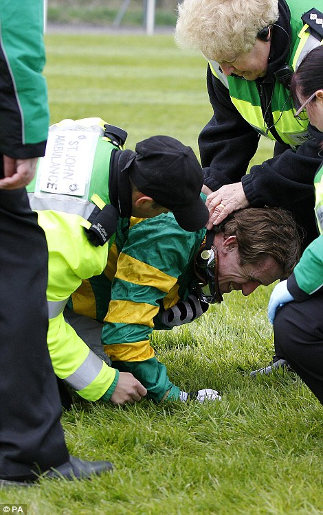 Tony McCoy is tended to by Paramedic after he falls at Bechers Brook