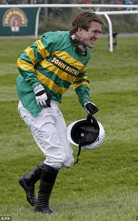 Tony McCoy grimaces after picking himself off the ground