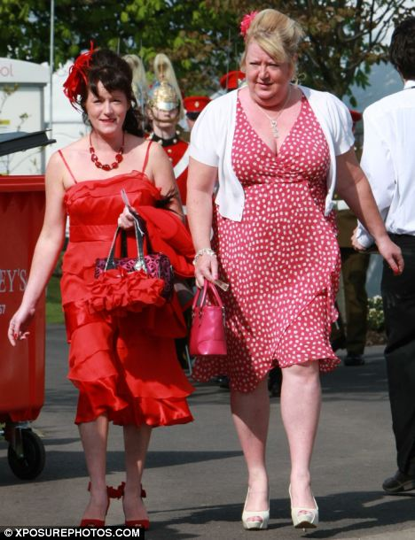 Ladies in red: Thousands of women flocked to Aintree for Ladies' Day on Friday