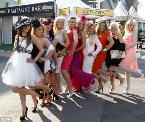 Striking a pose: There was much enthusiasm in the air as the ladies arrived at the Merseyside racecourse. But not from the PC