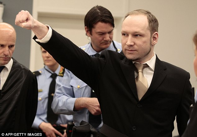 Defiant: Breivik then pumped his arm out, in what is believed to be a far-right salute, before saying he did not recognise the authority of the court