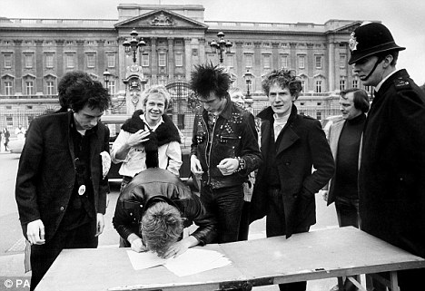 Anti-establishment: The Sex Pistols, with manager Malcolm McLaren signed a new record contract outside Buckingham Palace in 1977