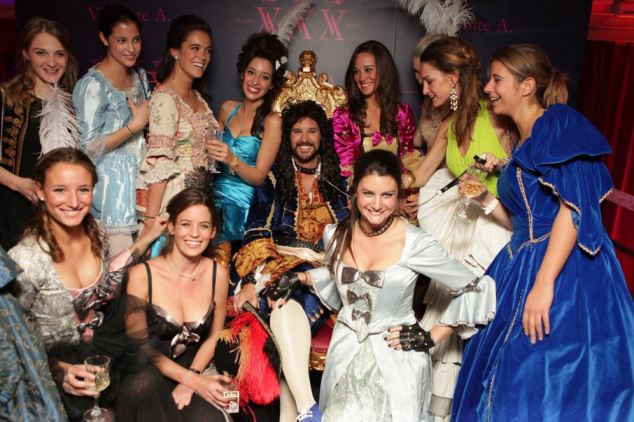 Decadent: The partygoers in fancy dress pose around the throne with Pippa
