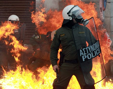 War zone: The eurozone countries face a tough 2012 as economies in Spain, Italy and Greece, which has already witnessed violent clashes, recede.