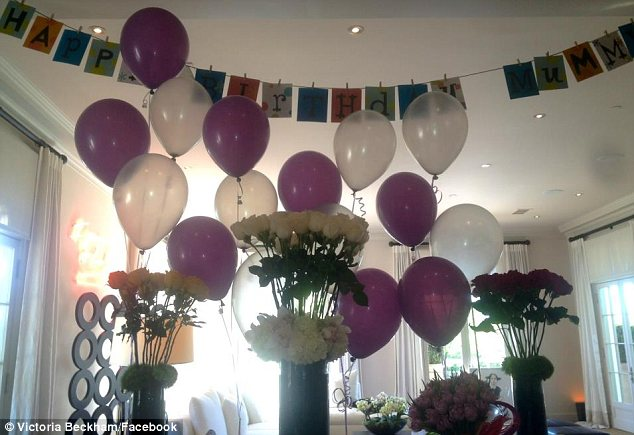 Life at the Beckhams: Victoria has posted a snap of a banner, balloons and flowers to celebrate turning 38 today