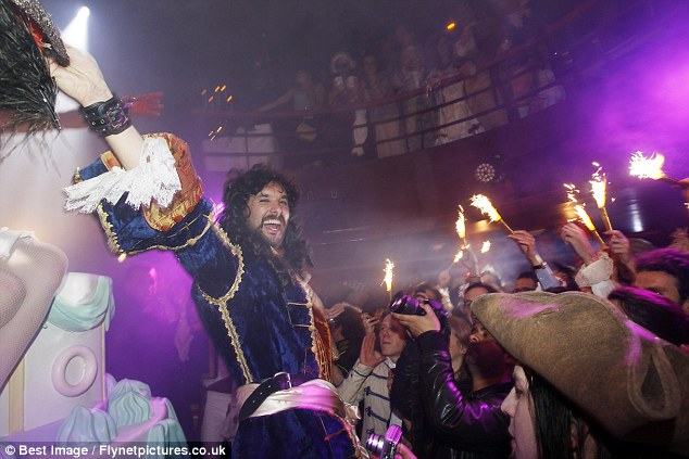 Party animal: Entrepreneur Vicomte de Soultrait appeared to revel in the party atmosphere at the Paris nightspot.