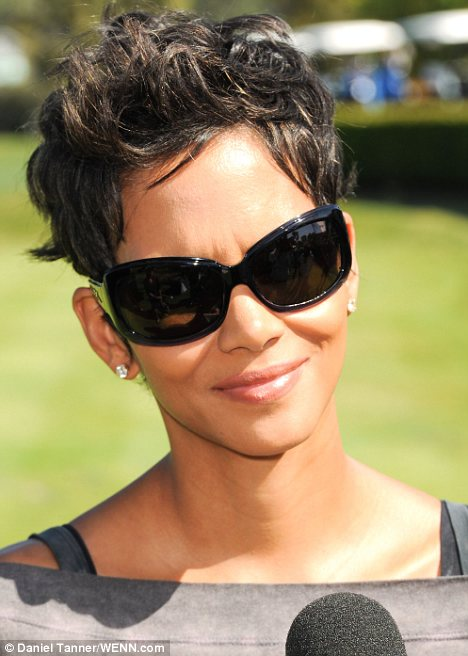 Warm weather: Halle wore a casual ensemble topped off with sunglasses for the golfing event