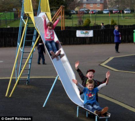 Still enjoyable: Children enjoy the slides in Wicksteed park on the exact same spot as children 90 years ago on the wooden slides
