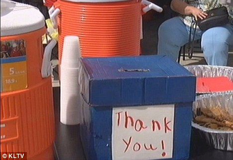 Sure hit: Drew charged 25 cents per cup after setting up his stall in his neighbourhood in Gladewater, Texas, last Saturday