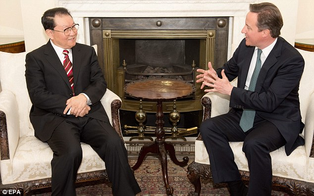 Keeping up the pressure: David Cameron meets China's propaganda chief Li Changchun at Downing Street today where he sought reassurances that the probe into Mr Heywood's death would follow due process