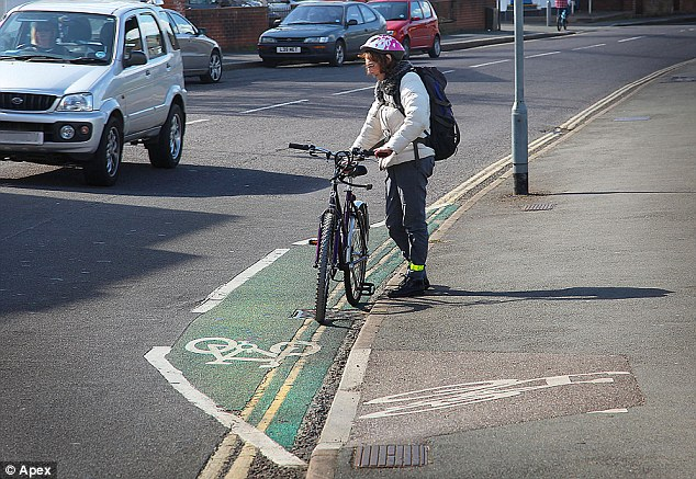 Baffled: A cyclist stops to try and work out what the lane's purpose is