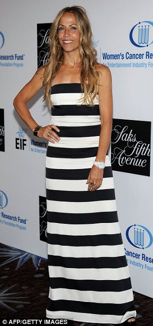 More demure looks: Singer Sheryl Crow opted for a black and white striped dress for the evening while