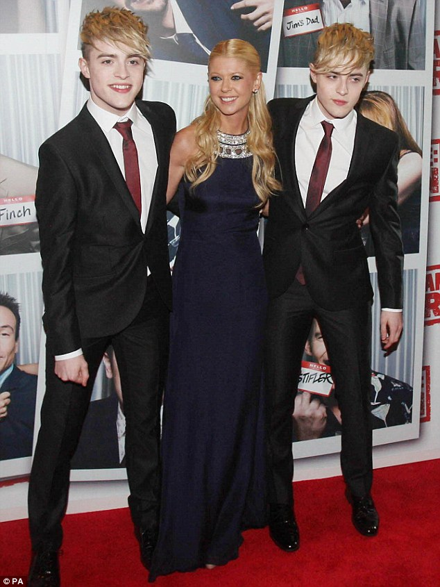 Understated: John and Edward ditched their quiffs for the occasion as they posed up with Tara on the red carpet