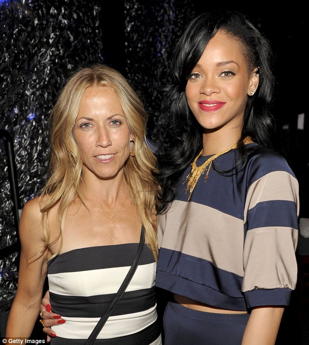 The striped effect: Sheryl posed up to Rihanna backstage at the event
