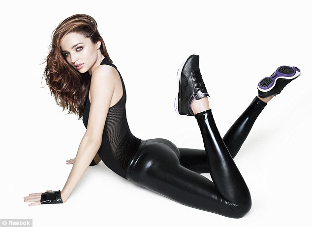 Smouldering: The model wears PVC leggings and mesh top to prove her flexing prowess in the campaign