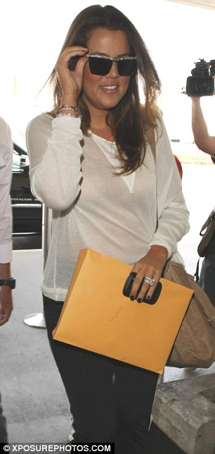 Mother daughter bonding: Kris Jenner (L) was seen arriving at LAX with Khloe (R) and Kim