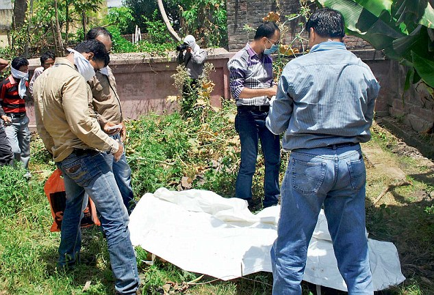 Gruesome discovery: Mumbai crime branch policemen recover the dead body of actress Meenakshi Thapa from Preeti Surin's house in Allahabad