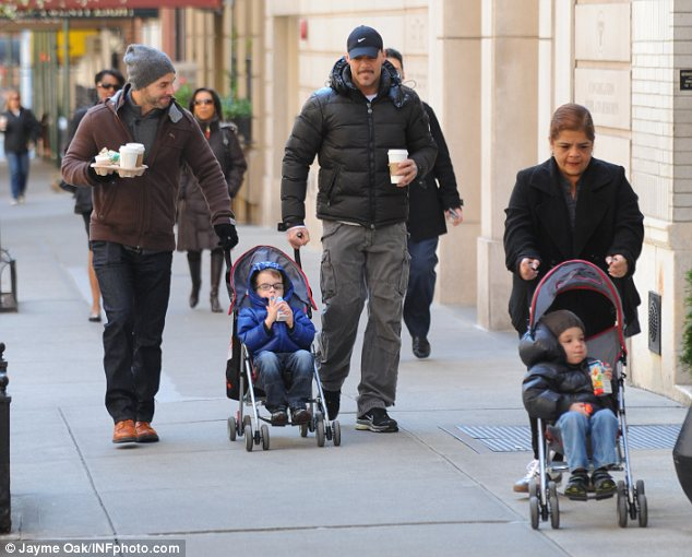 Daddies day care: Ricky Martin and his partner Carlos González Abella were seen enjoying a stroll with Ricky's twin sons earlier this month