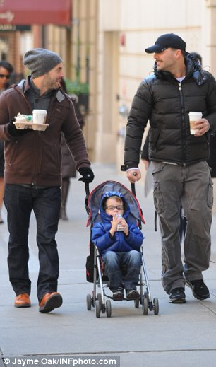 The look of love: The couple were seen sharing a joke and a warm look as they pushed one of Ricky's children along in a stroller